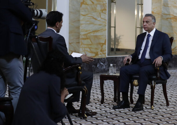 Iraqi Prime Minister Mustafa al-Kadhimi sits during an interview with The Associated Press in Baghdad, Iraq, Friday, July 23, 2021. (AP Photo/Khalid Mohammed)