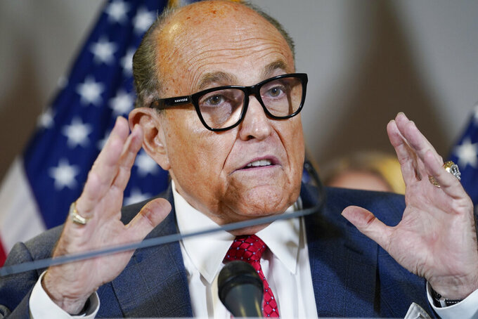 """FILE - In this Nov. 19, 2020, file photo, former New York Mayor Rudy Giuliani speaks during a news conference at the Republican National Committee headquarters in Washington. Giuliani's law license has already been suspended in his home state. That suspension, in practice, may well amount to a national suspension. A New York appeals court took the action in June, saying Giuliani's bid to discredit the election was so egregious that he poses """"an immediate threat"""" to the public. (AP Photo/Jacquelyn Martin, File)"""