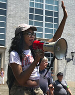 Meghan Thomas, third year law student at Northeastern University, speaks during a rally at the University, Wednesday, July 11, 2018, in Boston, where students and community activists demanded the school cancel a multimillion-dollar research contract with U.S. Immigration and Customs Enforcement. Federal spending data show that Northeastern has received $2.7 million from ICE over the last two years. Northeastern said the grant isn't funding research that has anything to do with immigration enforcement. (AP Photo/Sarah Betancourt)