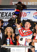 FILE - In this Sunday, Nov. 4, 2018, file photo, Kevin Harvick celebrates in Victory Lane after winning a NASCAR Cup auto race at Texas Motor Speedway in Fort Worth, Texas. Harvick's bid for a second NASCAR title suffered a massive setback when he was stripped of his berth in the championship race after series inspectors found his winning car from Texas Motor Speedway had been deliberately altered to give him a performance advantage. (AP Photo/Larry Papke, File)