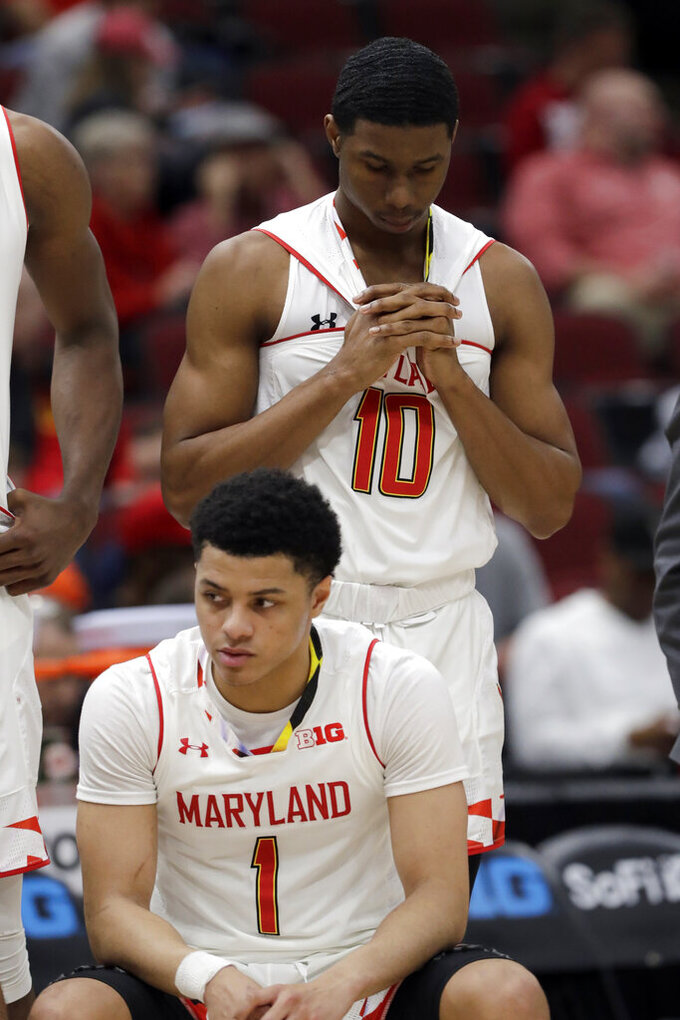 Maryland's Serrel Smith Jr. (10) and Anthony Cowan Jr. (1) react during the second half of an NCAA college basketball game against the Nebraska in the second round of the Big Ten Conference tournament, Thursday, March 14, 2019, in Chicago. The Nebraska won 69-61. (AP Photo/Nam Y. Huh)