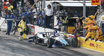 Takuma Sato collides with a member of his pit crew, knocking him to the ground, during the IndyCar auto race at Texas Motor Speedway, Saturday, June 8, 2019, in Fort Worth, Texas. (AP Photo/Brandon Wade)
