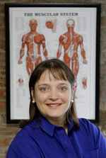 """In this Saturday, May 12, 2018, photo, April Oury, owner of Body Gears physical therapy center poses for a portrait at on of her centers in Chicago. Oury started her physical therapy practice 14 years ago wanting to give all aspects of her business the same focus and attention to detail she gave patients, even when it came to choosing paint colors or an internet provider. She wouldn't do it that way again. """"There was not enough time in the day or the workweek to put that kind of effort into every single thing,"""" says Oury. (AP Photo/Charles Rex Arbogast)"""