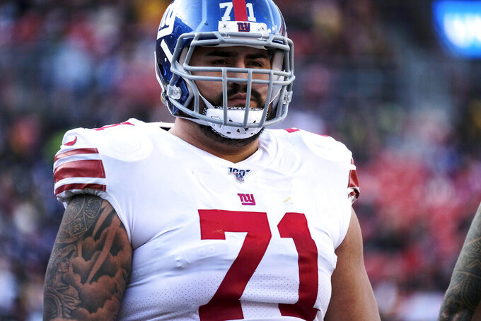 FILE - In this Dec. 22, 2019, file photo, New York Giants offensive guard Will Hernandez stands on the field during the team's NFL football game against the Washington Redskins in Landover, Md. Hernandez, who has started every game since being draft in 2018, was placed on the reserve COVID-19 list on Thursday, Oct. 29, after testing positive for the virus. (AP Photo/Mark Tenally, File)