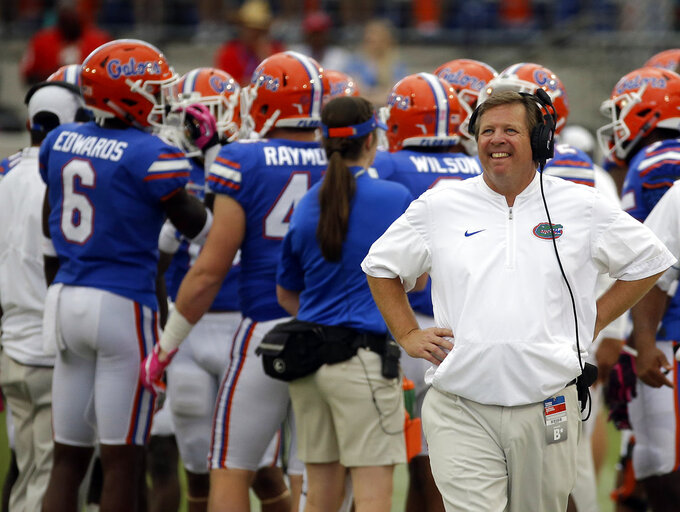 "FILE - In this Oct. 28, 2017, file photo, Florida head coach Jim McElwain, right, walks the sidelines during a timeout in the second half of an NCAA college football game against Georgia in Jacksonville, Fla. The ""Buyout Bowl"" was expected to be a blowout, until last week. Colorado State rallied to upset Arkansas. Florida loss to Kentucky. Now, not even former Rams and Gators coach Jim McElwain could accurately predict what will happen in the Swamp. Regardless, the one-off game is a seemingly awkward affair, an expensive reminder of McElwain's success at Colorado State and his failure at Florida. (AP Photo/John Raoux, File)"