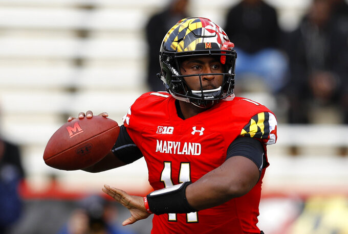 Maryland quarterback Kasim Hill throws to a receiver in the first half of an NCAA college football game against Illinois, Saturday, Oct. 27, 2018, in College Park, Md. (AP Photo/Patrick Semansky)