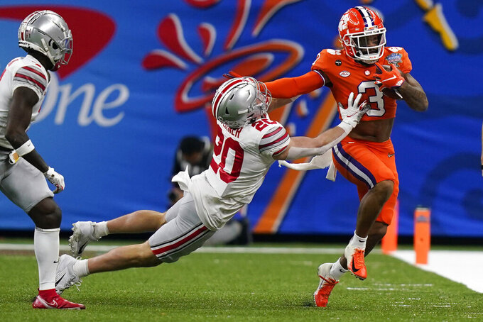 Clemson wide receiver Amari Rodgers, right, runs past Ohio State linebacker Pete Werner during the first half of the Sugar Bowl NCAA college football game Friday, Jan. 1, 2021, in New Orleans. (AP Photo/Gerald Herbert)