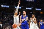 Seton Hall forward Sandro Mamukelashvili (23) passes the ball between Georgetown center Omer Yurtseven, left, and forward Jamorko Pickett (1) during the first half of an NCAA college basketball game, Wednesday, Feb. 5, 2020, in Washington. (AP Photo/Nick Wass)
