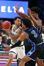 Georgia Tech guard Jose Alvarado (10) is covered by Duke's Tre Jones (3) and Vernon Carey Jr. (1) as he tries to pass in the first half of an NCAA college basketball game Wednesday, Jan. 8, 2020, in Atlanta. (AP Photo/John Bazemore)