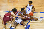 Duke forward Henry Coleman III, front, passes to Duke guard Jeremy Roach (3) as Boston College guard Demarr Langford Jr., middle left, and teammate, center, Justin Vander Baan, left, defend during the second half of an NCAA college basketball game in the first round of the Atlantic Coast Conference tournament in Greensboro, N.C., Tuesday, March 9, 2021. (AP Photo/Gerry Broome)