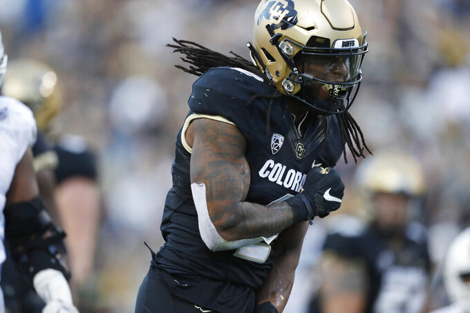 Colorado wide receiver Laviska Shenault Jr. reacts after running for a first down to set up the winning field goal late in the second half of an NCAA college football game against Stanford, Saturday, Nov. 9, 2019, in Boulder, Colo. Colorado won 16-13. (AP Photo/David Zalubowski)