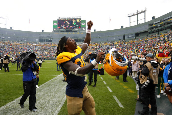 Green Bay Packers running back Jamaal Williams celebrates as he walks off the field following a 27-16 victory over the Denver Broncos in an NFL football game Sunday, Sept. 22, 2019, in Green Bay, Wis. (AP Photo/Matt Ludtke)