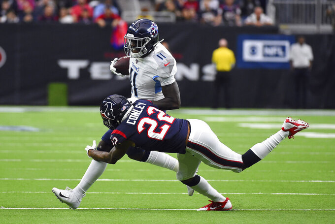Tennessee Titans wide receiver A.J. Brown (11) is tackled by Houston Texans cornerback Gareon Conley (22) during the first half of an NFL football game Sunday, Dec. 29, 2019, in Houston. (AP Photo/Eric Christian Smith)