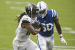 Jacksonville Jaguars wide receiver Laviska Shenault Jr., left, scores a touchdown on a 16-yard pass play in front of Indianapolis Colts defensive end Justin Houston during the first half of an NFL football game, Sunday, Sept. 13, 2020, in Jacksonville, Fla. (AP Photo/Stephen B. Morton)