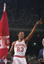 FILE - In this March 30, 1987, file photo, Indiana's Keith Smart gives the number one sign after Indiana won the NCAA college basketball championship against Syracuse in New Orleans.  Indiana defeated Syracuse 74-73. (AP Photo/File)