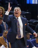 Auburn head coach Bruce Pearl shouts to his team in the first half during a first round men's college basketball game in the NCAA Tournament, against New Mexico State Thursday, March 21, 2019, in Salt Lake City. (AP Photo/Rick Bowmer)