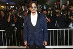 FILE - In this Sept. 6, 2019 file photo, Johnny Depp arrives at the premiere of