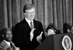 FILE - In this Feb. 1, 1980, file photo, President Jimmy Carter pauses during the beginning of his speech in Washington, to a national conference on physical fitness and sports to applaud the efforts of the U.S. Olympic Committee's stand on the Moscow Olympics. (AP Photo/Mark Wilson, File)