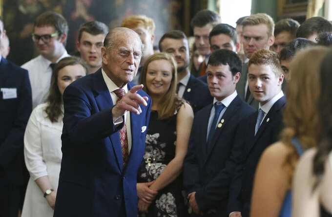 FILE - In this May 25, 2017 file photo, Britain's Prince Philip, the Duke of Edinburgh, hosts the Duke of Edinburgh's Award gold award presentations at Hillsborough Castle, Belfast, northern Ireland. Prince Philip, the irascible and tough-minded husband of Queen Elizabeth II who spent more than seven decades supporting his wife in a role that both defined and constricted his life, has died, Buckingham Palace said Friday, April 9, 2021. He was 99. (Brian Lawless/PA via AP, File)