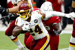Washington Football Team running back Antonio Gibson (24) looks to run against the Arizona Cardinals during the first half of an NFL football game, Sunday, Sept. 20, 2020, in Glendale, Ariz. (AP Photo/Darryl Webb)