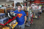 Born To Game owner James Jerman stands in his game and comic book store on Sept. 10, 2021, in South Dover, Del. he reached for a Spider-Man comic book that was marked by the first appearance of The Punisher — worth $13,000 — and it was quickly apparent that while owning Born to Game in Dover can be fun and games, it can also be serious business. (Marc Clery/Delaware State News via AP)
