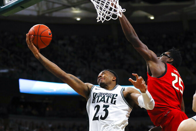 Michigan State forward Xavier Tillman (23) drives on Maryland forward Jalen Smith (25) in the second half of an NCAA college basketball game in East Lansing, Mich., Saturday, Feb. 15, 2020. (AP Photo/Paul Sancya)