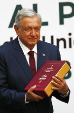 Mexican President Andrés Manuel López Obrador holds his first year's government report, before giving his state of the nation address at the National Palace in Mexico City, Sunday, Sept. 1, 2019. (AP Photo/Marco Ugarte)