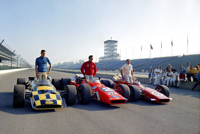 FILE - In this May 24, 1969, file photo, from left to right: Al Unser, Mario Andretti, and A.J. Foyt, the front row in the upcoming Indianapolis 500 auto race, pose for photos in Indianapolis. Andretti and Unser's rivalry is one of the most famous in the long history of the Indianapolis 500. (AP Photo, File)