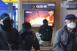 People watch a TV screen showing a file image of North Korea's missile launch during a news program at the Seoul Railway Station in Seoul, South Korea, Sunday, March 29, 2020. North Korea on Sunday fired two suspected ballistic missiles into the sea, South Korea said, calling it