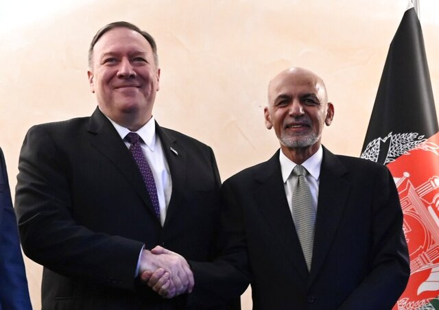 US Secretary of State Mike Pompeo, left, shakes hands with Afghan President Ashraf Ghani,during the 56th Munich Security Conference (MSC) in Munich, southern Germany, on Friday, Feb. 14, 2020. The 2020 edition of the Munich Security Conference (MSC) takes place from Feb. 14 to 16. (Andrew Caballero-Reynolds/Pool photo via AP)