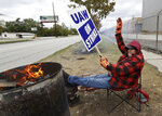 Ray Geyser, a 21-year General Motors employee, pickets outside the General Motors Fabrication Division, Wednesday, Oct. 16, 2019, in Parma, Ohio. Bargainers for General Motors and the United Auto Workers reached a tentative contract deal on Wednesday that could end a monthlong strike that brought the company's U.S. factories to a standstill. (AP Photo/Tony Dejak)