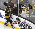 Boston Bruins right wing David Pastrnak (88) celebrates with fans after his goal off Columbus Blue Jackets goaltender Sergei Bobrovsky (not shown) during the third period of Game 5 of an NHL hockey second-round playoff series, Saturday, May 4, 2019, in Boston. (AP Photo/Charles Krupa)