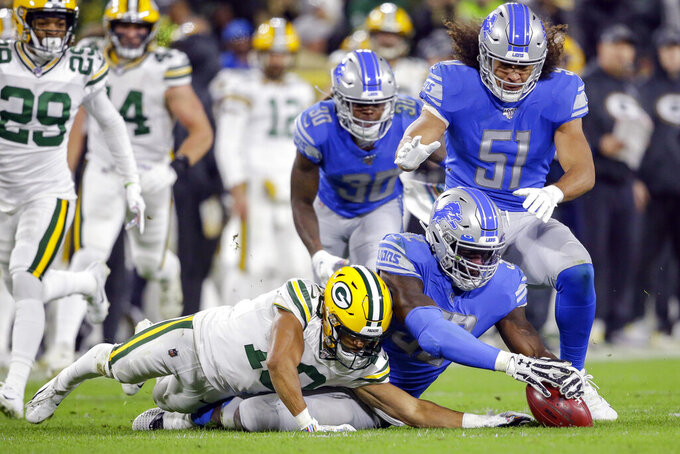 Detroit Lions outside linebacker Christian Jones (52) recovers a punt fumbled by Green Bay Packers wide receiver Darrius Shepherd (10) during the second half of an NFL football game Monday, Oct. 14, 2019, in Green Bay, Wis. (AP Photo/Jeffrey Phelps)