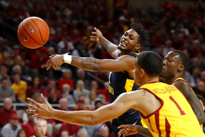 West Virginia forward Derek Culver, left, vies for a loose ball with Iowa State's Cameron Lard, right, and Nick Weiler-Babb (1) during the first half of an NCAA college basketball game Wednesday, Jan. 30, 2019, in Ames, Iowa. (AP Photo/Charlie Neibergall)