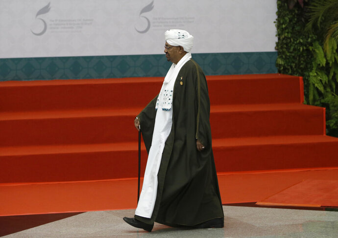FIE - In this March 7, 2016 file photo, Sudan's President Omar al Bashir walks to the stage prior to a group photo session at the Organization of Islamic Cooperation summit  in Jakarta, Indonesia. In Jan. 2019, with violent anti-government protests into their fourth week, Sudan appears headed toward political paralysis, with drawn out unrest across much of the country and a fractured opposition. No one is clear on what happens after al-Bashir. (AP Photo/Dita Alangkara, File)