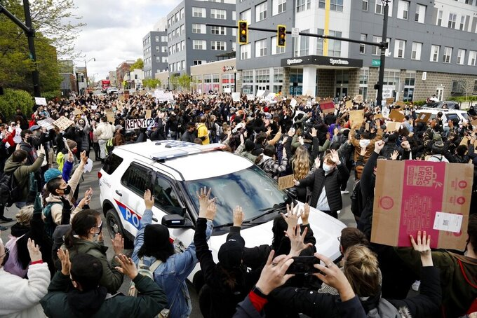 FILE - In this April 21, 2021, file photo, Ohio State students gathering on High Street to protest the police shooting of Ma'Khia Bryant in Columbus, Ohio. U.S. Sen. Sherrod Brown and U.S. Rep. Joyce Beatty, along with Oregon Rep. Ron Wyden, are calling for an investigation into the events that led to the police shooting Ma'Khia Bryant in Columbus last April. (Kyle Robertson/The Columbus Dispatch via AP, File)