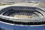 FILE - This is an April 6, 2020, file photo showing an empty MetLife Stadium in East Rutherford, N.J. As contingency plans are made for playing in empty stadiums, or pushing back the schedule _ and the Super Bowl, perhaps even beyond February _  or even for games at neutral sites, rest assured the NFL has no plans to not play. (AP Photo/Ted Shaffrey)