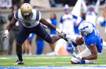 Air Force quarterback Isaiah Sanders (4) gains yards as he is brought down by Navy cornerback Jarid Ryan (2) during an NCAA college football game at Falcon Stadium at the U.S. Air Force Academy, Saturday Oct. 6, 2018, in Colorado Springs, Colo.  (Dougal Brownlie,/The Gazette via AP)