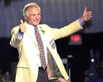 FILE - In this Aug. 3, 2001, file photo, Nick Buoniconti, former Boston Patriots and Miami Dolphins linebacker, gives two thumbs up while being introduced at the Pro Football Hall of Fame Enshrinees Civic Dinner in Canton, Ohio. Pro Football Hall of Fame middle linebacker Nick Buoniconti, an undersized overachiever who helped lead the Miami Dolphins to the NFL's only perfect season, has died at the age of 78. Bruce Bobbins, a spokesman for the Buoniconti family, said he died Tuesday, July 30, 2019, in Bridgehampton, N.Y. (Damon J. Moritz/Independent via AP, File)