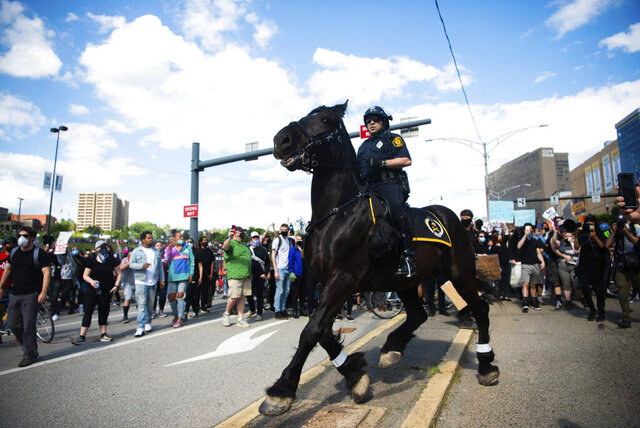 A mounted unit helps keep order during a protest against the death of George Floyd, Saturday, May 30, 2020, in Pittsburgh. People nationwide protested the Memorial Day death of Floyd, who died in police custody in Minneapolis. (Shane Dunlap/Pittsburgh Tribune-Review via AP)