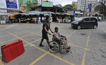 A Sri Lankan army soldier wheels another soldier to a medical clinic outside the National Hospital during a day long token strike by the members of Government Medical Officers Association in Colombo, Sri Lanka, Wednesday, Sept. 18, 2019. The trade union action is to demand the government resolve salary anomalies faced by the doctors serving at state-run hospitals. (AP Photo/Eranga Jayawardena)