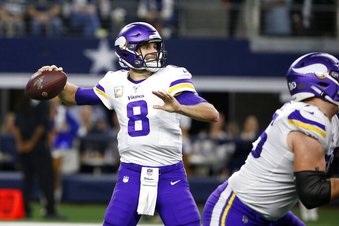 Minnesota Vikings quarterback Kirk Cousins (8) throws a pass during the first half of the team's NFL football game against the Dallas Cowboys in Arlington, Texas, Sunday, Nov. 10, 2019. (AP Photo/Ron Jenkins)
