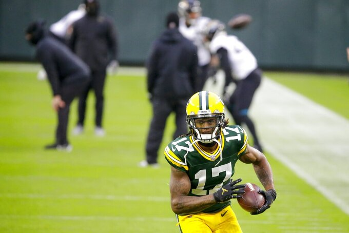 Green Bay Packers' Davante Adams warms up before an NFL football game against the Jacksonville Jaguars Sunday, Nov. 15, 2020, in Green Bay, Wis. (AP Photo/Mike Roemer)