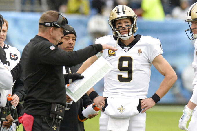 New Orleans Saints quarterback Drew Brees (9) talks with head coach Sean Payton in the first half of an NFL football game against the Tennessee Titans Sunday, Dec. 22, 2019, in Nashville, Tenn. (AP Photo/Mark Zaleski)