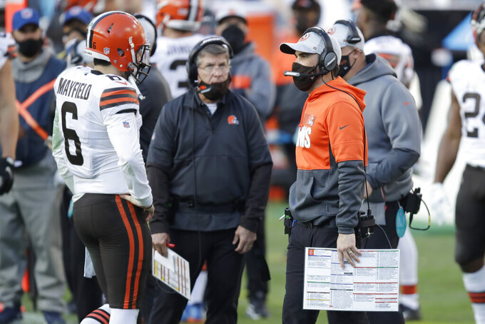 Cleveland Browns head coach Kevin Stefanski, right, talks with quarterback Baker Mayfield (6) in the second half of an NFL football game against the Tennessee Titans Sunday, Dec. 6, 2020, in Nashville, Tenn. (AP Photo/Ben Margot)