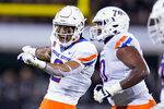 Boise State wide receiver Khalil Shakir celebrates his touchdown on a 23-yard pass reception with offensive lineman John Ojukwu, right, during the first half of the team's NCAA college football game against Central Florida, Thursday, Sept. 2, 2021, in Orlando, Fla. (AP Photo/John Raoux)