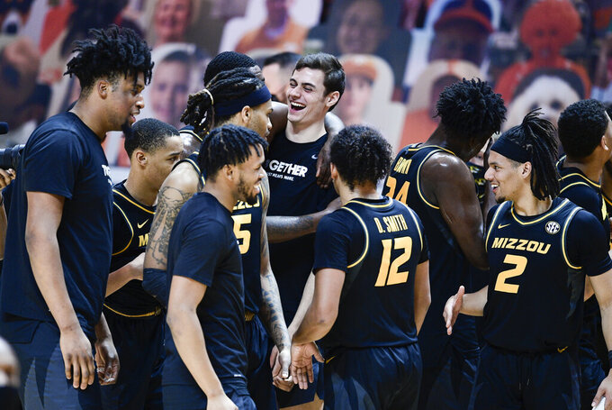 Missouri players react after defeating Tennessee in an NCAA college basketball game Saturday, Jan. 23, 2021, in Knoxville, Tenn. (Calvin Mattheis/Knoxville New-Sentinel via AP, Pool)