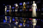 """Costumes worn in the film """"Wonder Woman 1984"""" are displayed in the """"Action and Magic Made Here"""" interactive experience at the Warner Bros. Studio Tour Hollywood media preview on June 24, 2021, in Burbank, Calif. (AP Photo/Chris Pizzello)"""