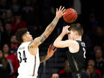 Cincinnati guard Jarron Cumberland (34) knocks the ball from Central Florida guard Matt Milon (2) during the first half of an NCAA college basketball game Wednesday, Feb. 19, 2020, in Cincinnati. (Albert Cesare/The Cincinnati Enquirer via AP)