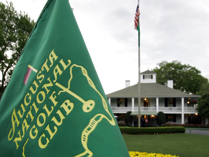 """FILE - In this April 4, 2007, file photo, cloudy skies appear above the clubhouse at the Augusta National Golf Club in Augusta, Ga. The Par 3 Contest is out at the spectator-free Masters in November. ESPN's """"College GameDay"""" is in. Augusta National announced Tuesday, Oct. 27, 2020, more changes to a Masters tournament that will be unlike any of the previous 83. The most unusual of all is ESPN's popular college football pregame show taking place on a stage that overlooks Ike's Pond and the ninth green of the Par 3 course. (AP Photo/David J. Phillip, File)"""